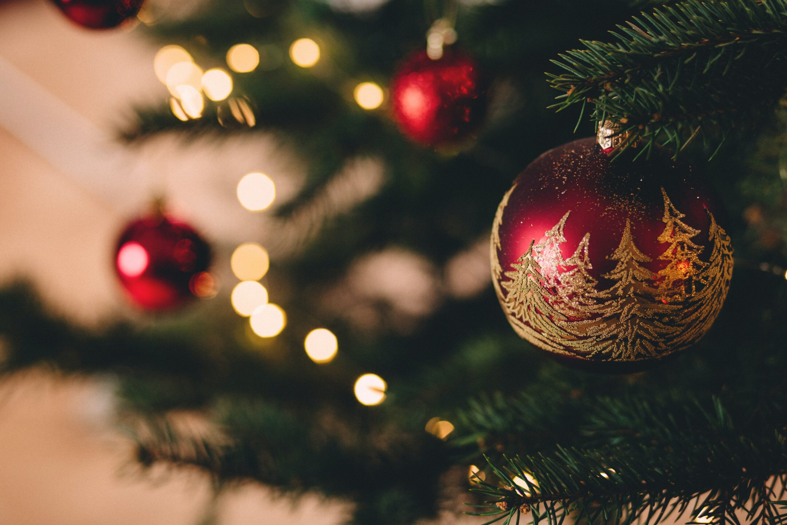 Baubles handing on Christmas tree in Polmanter's self catering accommodation for Christmas and New Year holidays