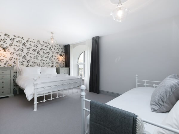 Spacious bedroom with king size bed and sofa in Polmanter Touring Park