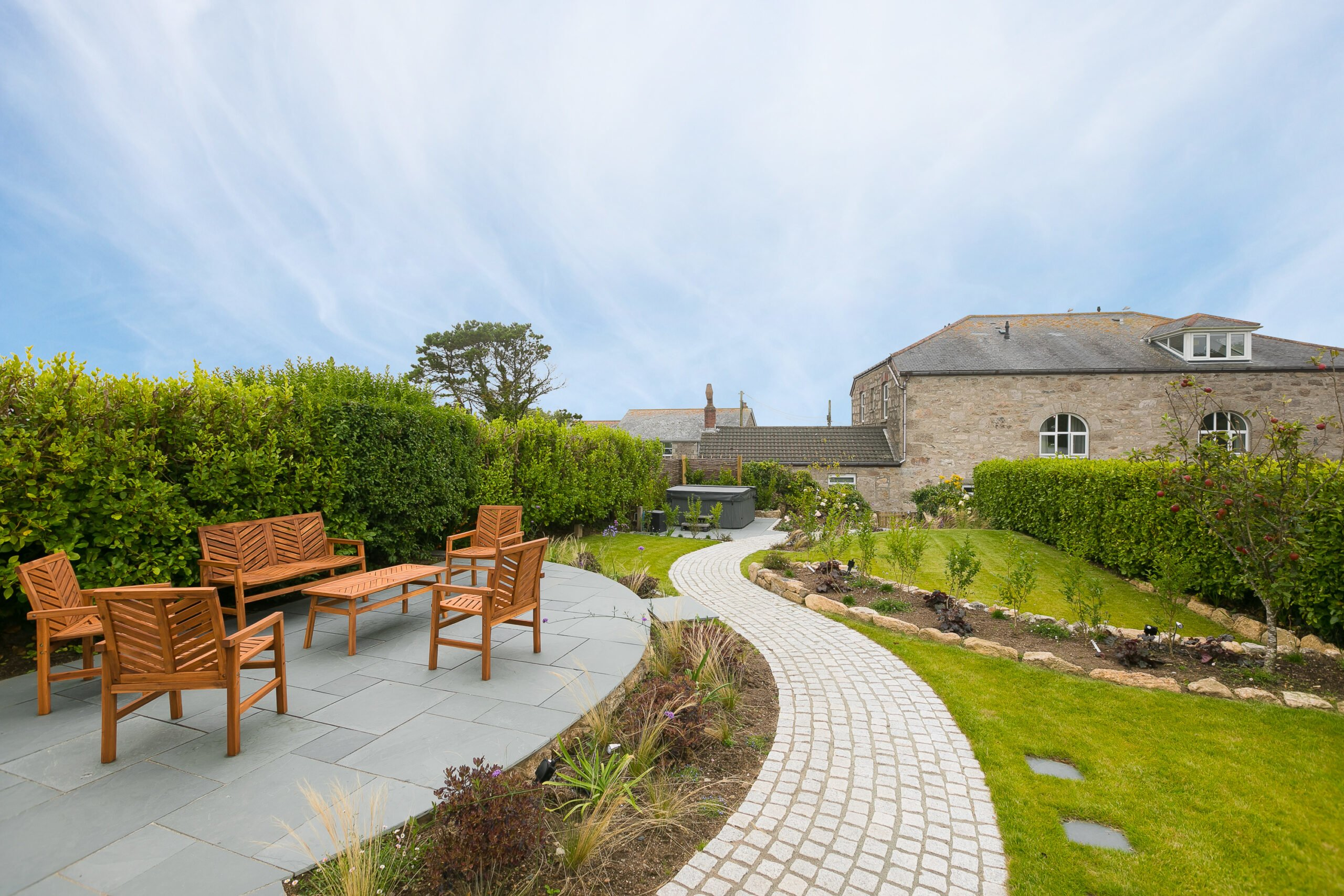 Landscaped garden at Polmanter Touring Park's self-catering holiday cottage St Ives