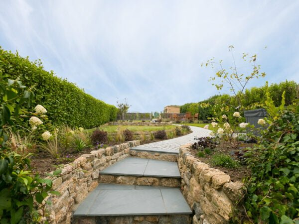 Steps up to the landscaped garden at Polmanter Touring Park