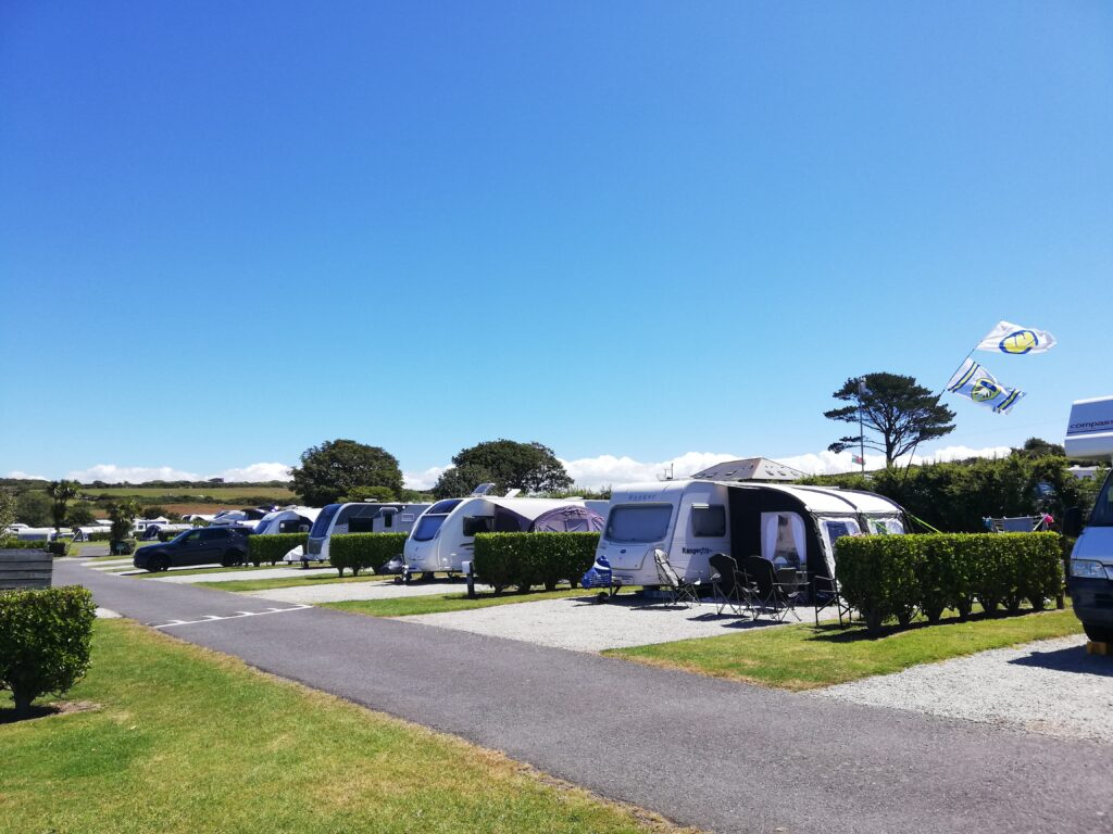 Caravans pitched up on spacious plots at Polmanter Touring Park in St Ives