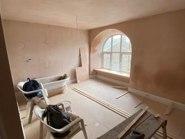 Polmanter holiday cottage renovation in the first bedroom with plastered walls