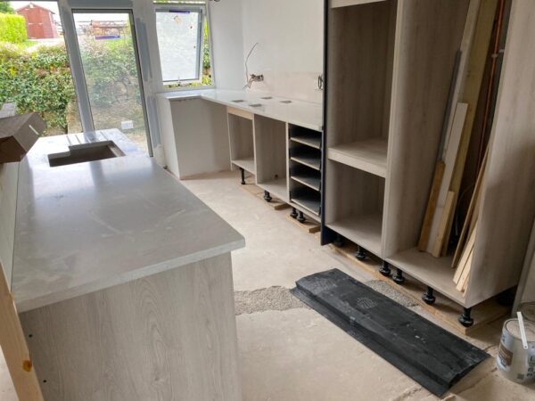 Polmanter holiday cottage renovation putting in the kitchen units