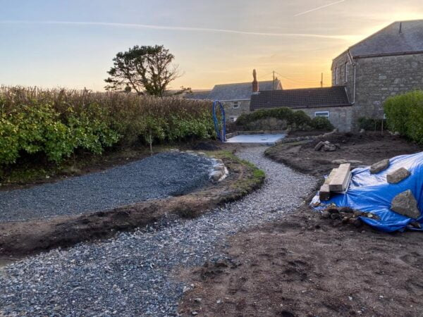 Sunset view of the landscaped garden in process at the Polmanter holiday cottage renovation
