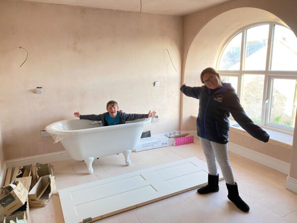 Kerenza and William showcase the roll top bath going into bedroom one