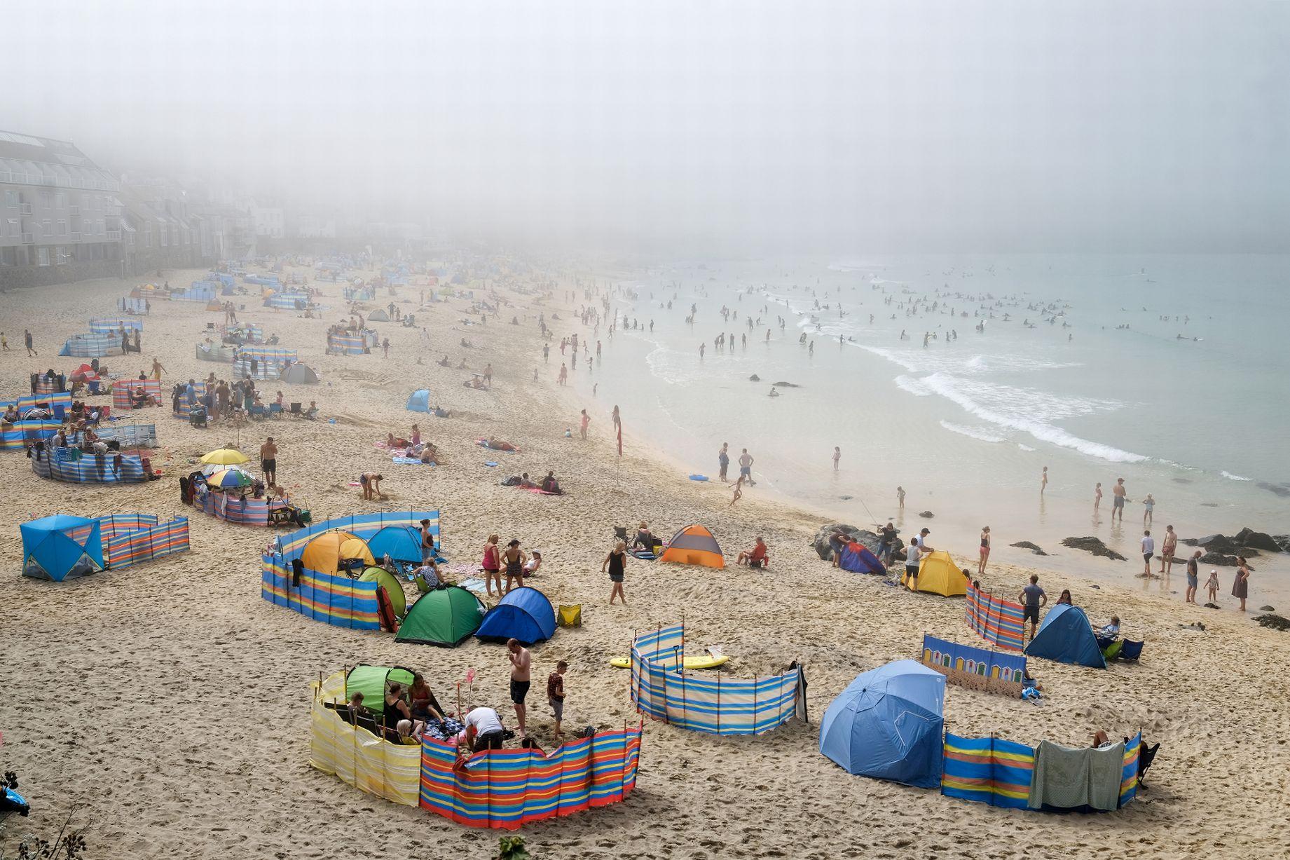 Mist over Porthmeor Beach on a foggy day in Cornwall