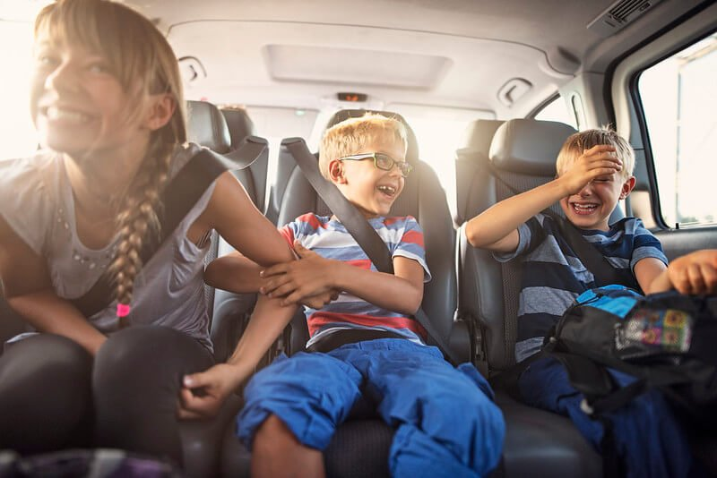 Three children sat in the car travelling to Cornwall